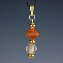 Pendant with Roman semi-translucent glass & carnelian beads