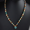 Necklace with Roman turquoise glass, shell, carnelian beads