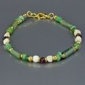 Bracelet with Roman green glass, shell and garnet beads
