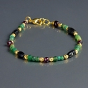 Bracelet with Roman green and black glass with garnet beads