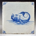 Dutch Delft blue and white tile with sea monster