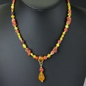 Necklace with Roman yellow, red and amber colour glass beads