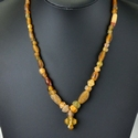 Necklace with Roman amber colour glass and alabaster beads