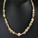 Necklace with Egyptian faience, coral, shell and stone beads