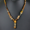Necklace with Roman amber colour glass beads