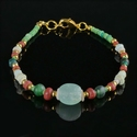 Bracelet with Roman green, red glass and shell beads