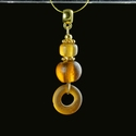 Pendant with Roman amber colour glass beads