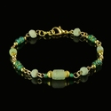 Bracelet with Roman green glass and faience beads