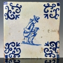 Dutch Delft blue and white tile, defecating man, very rare
