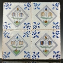 Dutch Delft polychrome tableau of four tiles with flowers