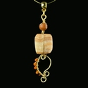 Pendant with Roman wire-wrapped orange glass, stone beads