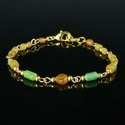 Bracelet with Roman green and amber colour glass beads