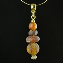 Pendant with Roman glass and amber beads
