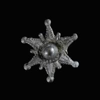 Medieval pewter badge, Star
