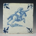 Dutch Delft blue and white tile with musketeer